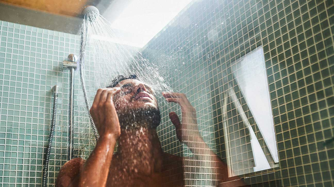 Cropped shot of a handsome young man having a refreshing shower at home 954670786